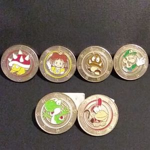 6 Super Mario metal coins from wonderball candy.